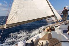 Sailors participate in sailing regatta 16th Ellada. MILOS, GREECE - SEP 27, 2016: Sailors participate in sailing regatta 16th Ellada Autumn 2016 among Greek Royalty Free Stock Image