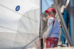 Sailors participate in sailing regatta 16th Ellada. POROS, GREECE - SEP 29, 2016: Sailors participate in sailing regatta 16th Ellada Autumn 2016 among Greek Royalty Free Stock Images