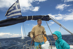 Sailors participate in sailing regatta 11th Ellada Spring 2014 among Greek island group in the Aegean Sea Royalty Free Stock Photos