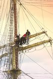 Sailors on sailboat rigging. Sailors in the top rigging of the mast of a sailboat or tall ship Royalty Free Stock Photo