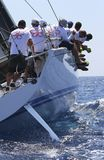 Crew teamwork during sailing regatta