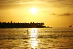 Sailors in sunset Stock Photo