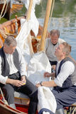 Sailors in vintage clothes preparing old sailing ships Royalty Free Stock Photos