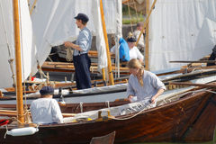 Sailors in vintage clothes preparing old sailing ships Stock Photo