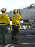 Sailors at work on flight deck stock image