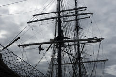 Sailors working aloft in the rigging, traditional tallship Stock Photo