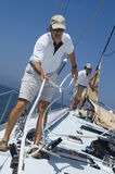Sailors Working Ropes On Yacht Deck Royalty Free Stock Photo