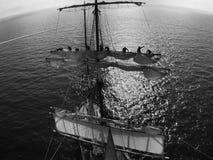 Sailors on the yard furling a sail Stock Photos