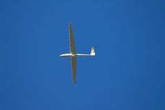 Sailplane. A sailplane in front of a blue sky glides through the air without its own motor drive Royalty Free Stock Photos