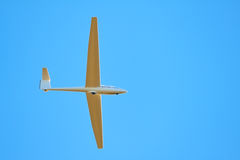 Sailplane. A sailplane in front of a blue sky glides through the air without its own motor drive Stock Photography