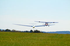 Sailplane. A sailplane in front of a blue sky glides through the air without its own motor drive Stock Photos