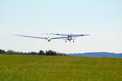 Sailplane. A sailplane in front of a blue sky glides through the air without its own motor drive Stock Image