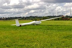 Sailplane, glider airplane wide angle shot on the ground field Royalty Free Stock Photography