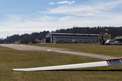 Sailplane glider on south germany airfield. With green grass and blue sky sunny easter springtime day Stock Photos