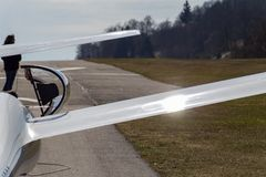 Sailplane glider on south germany airfield. With green grass and blue sky sunny easter springtime day Royalty Free Stock Photo