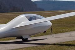 Sailplane glider on south germany airfield. With green grass and blue sky sunny easter springtime day Stock Photo