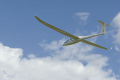 Sailplane gliding through the sky. Stock Photos