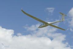 Sailplane gliding through the sky. Stock Photos