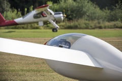 A sailplane and his towing aircraft on an airfield Stock Photography