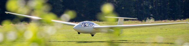 Sailplane landing on an airfield Royalty Free Stock Photography
