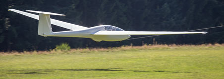 Sailplane landing on an airfield Royalty Free Stock Photo