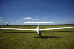 Sailplane landing on a grass, sunny day in Szczecin. Royalty Free Stock Image