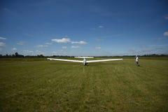 Sailplane landing on a grass, sunny day in Szczecin. stock photo
