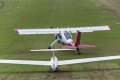 Sailplane and a towing aircraft starting on an airfield Stock Images