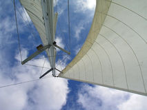 Sails. And mast pointing up to the sky withe clouds Royalty Free Stock Photo