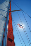 Sails and American flag against blue sky Royalty Free Stock Photography
