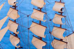 Sails on blue background stock photography