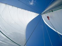 Sails on the blue sky. Stock Photography
