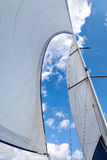 Sails filled with wind against the sky with clouds Stock Photo