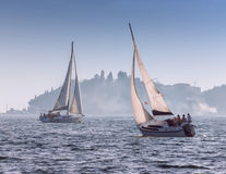 Sails in the fog Stock Photography
