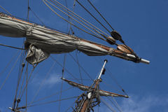 Sails on a fore topmast of retro sailing ship frigate. Sails on a fore topmast of XVII century sailing ship frigate Stock Image