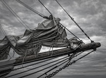 Sails Furled. On the bow sprint of a classic schooner Stock Photography