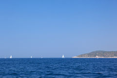 Sails on the horizon. Royalty Free Stock Image
