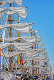 The sails of large sailboats in a row. Amsterdam, Netherlands - August 20: SAIL Amsterdam 2015 is an immense flotilla of Tall Ships, maritime heritage, naval Stock Photography