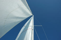 Sails and mast. White sails and mast and the blue sky royalty free stock image