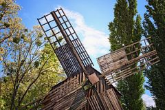 Sails of the old typical wooden windmill. Concept of historical buildings in ancient Ukrainian village. Pereyaslav-Khmelnitsky Museum of Folk Architecture and stock images