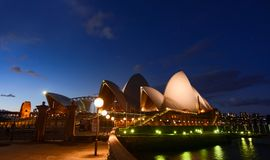 The sails of the Sydney Opera House glow under a starry night sky Royalty Free Stock Photos