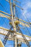 Sails and tackles of a sailing vessel on a background of the sky Stock Photo