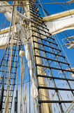Sails and tackles of a sailing vessel on a background of the sky Royalty Free Stock Photo