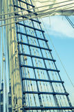 Sails and tackles of a sailing vessel on a background of the sky Stock Photos