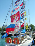 Sailship Akela with small flags  in  port of Sochi. Royalty Free Stock Photos