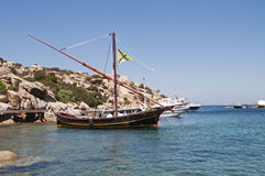 Sailship in a beautiful small seaport Royalty Free Stock Photo