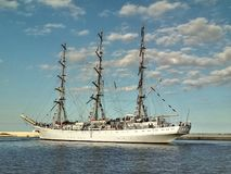 Sailship in harbor. Tall ship Dar Mlodziezy with three masts manoeuvring in a harbor of Gdynia, northern Poland Royalty Free Stock Photo