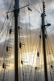 Sailship poles in the setting sun Royalty Free Stock Photo