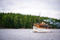 Saimaa. Boat passing by in lake Saimaa stock photo