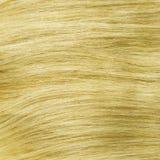 Sain blond jaune agrafe-dans la texture de cheveux photo stock